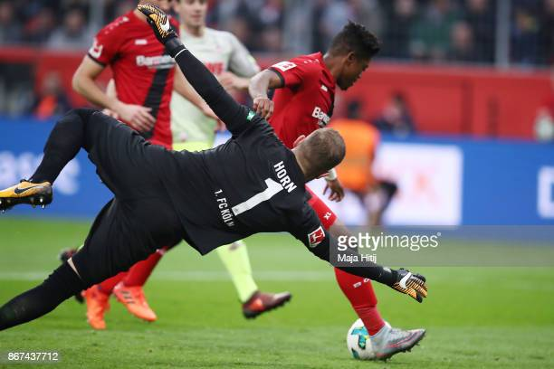 Leon Bailey of Bayer Leverkusen goes past Timo Horn of Koeln to score his teams first goal to make it 1:1 during the Bundesliga match between Bayer...