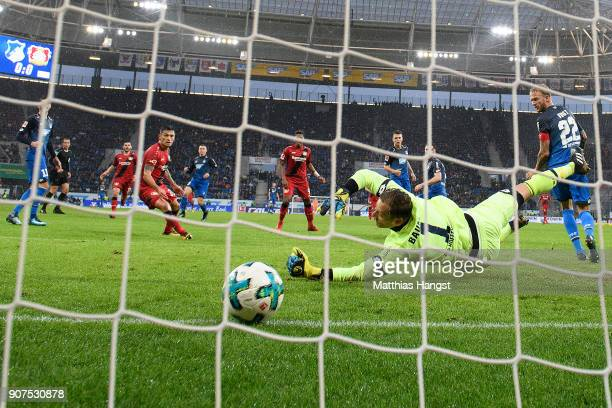 Leon Bailey of Bayer Leverkusen scores a goal past goalkeeper Oliver Baumann of Hoffenheim to make it 01 during the Bundesliga match between TSG 1899...