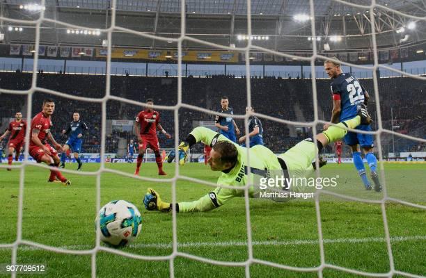 Leon Bailey of Bayer Leverkusen scores a goal past goalkeeper Oliver Baumann of Hoffenheim to make it 0:1 during the Bundesliga match between TSG...