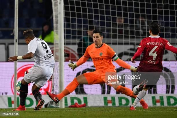 Leon Bailey of Bayer Leverkusen scores his team's equalizing goal goal against Philipp Tschauner of Hannover 96 to make it 33 during the Bundesliga...