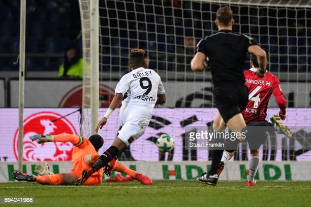 Leon Bailey of Bayer Leverkusen scores his team's equalizing goal against Philipp Tschauner of Hannover 96 to make it 33 during the Bundesliga match...