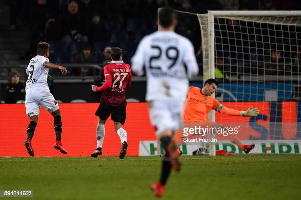 Leon Bailey of Bayer Leverkusen scores his team's fourth goal against Philipp Tschauner of Hannover 96 to make it 34 during the Bundesliga match...
