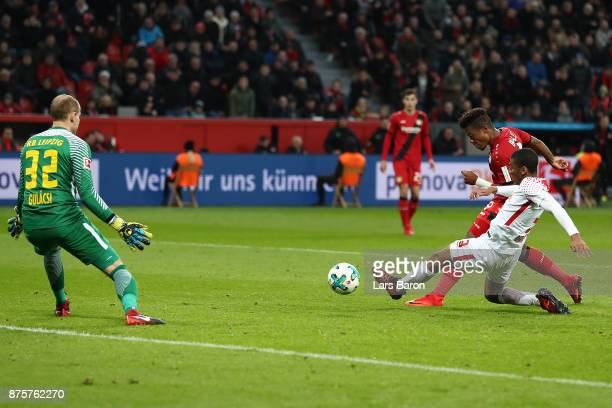 Leon Bailey of Bayer Leverkusen shoots to score his teams first goal to make it 11 during the Bundesliga match between Bayer 04 Leverkusen and RB...