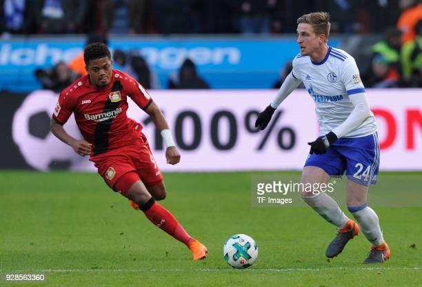 Leon Bailey of Leverkusen and Bastian Oczipka of Schalke battle for the ball during the Bundesliga match between Bayer 04 Leverkusen and FC Schalke...