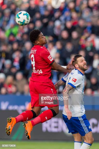Leon Bailey of Leverkusen and Guido Burgstaller of Schalke battle for the ball during the Bundesliga match between Bayer 04 Leverkusen and FC Schalke...