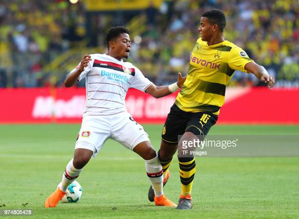 Leon Bailey of Leverkusen and Manuel Akanji of Dortmund battle for the ball during the Bundesliga match between Borussia Dortmund and Bayer 04...