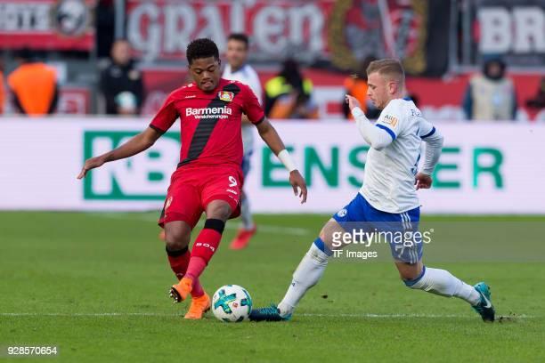 Leon Bailey of Leverkusen and Max Meyer of Schalke battle for the ball during the Bundesliga match between Bayer 04 Leverkusen and FC Schalke 04 at...