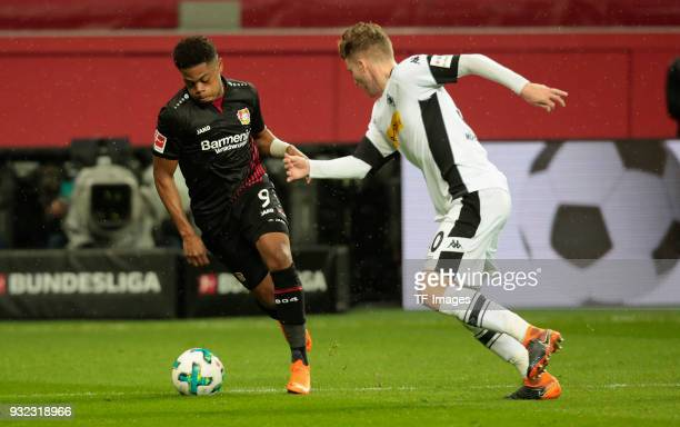 Leon Bailey of Leverkusen and Nico Elvedi of Moenchengladbach battle for the ball during the Bundesliga match between Bayer 04 Leverkusen and...