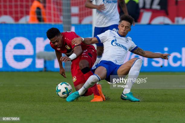 Leon Bailey of Leverkusen and Thilo Kehrer of Schalke battle for the ball during the Bundesliga match between Bayer 04 Leverkusen and FC Schalke 04...