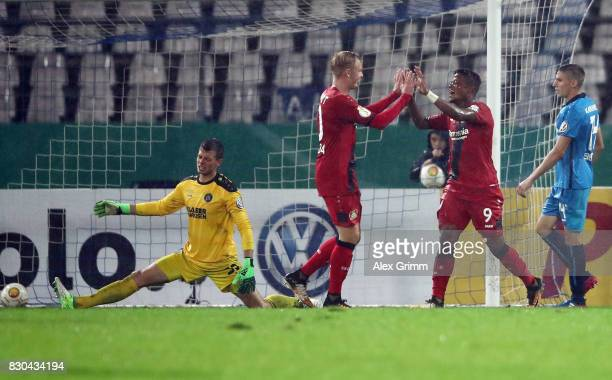 Leon Bailey of Leverkusen celebrates his team's third goal with team mate Julian Brandt during the DFB Cup first round match between Karlsruher SC...