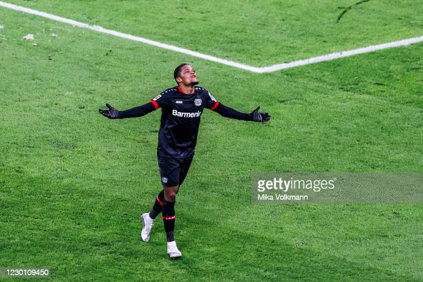 Leon Bailey of Leverkusen celebrates scoring the 2:0 against goalkeeper Oliver Baumann of Hoffenheim during the Bundesliga match between Bayer 04...