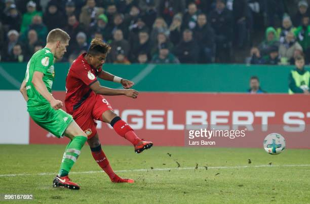 Leon Bailey of Leverkusen scores his teams first goal during the DFB Cup match between Borussia Moenchengladbach and Bayer Leverkusen at BorussiaPark...