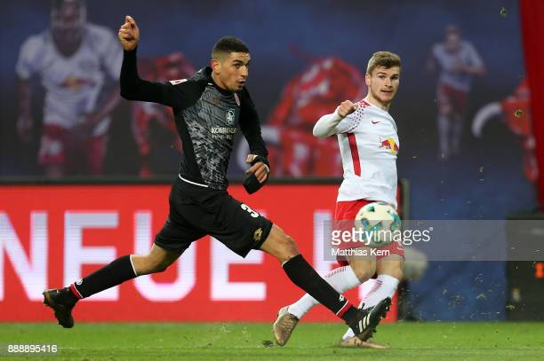 Leon Balogum of Mainz battles for the ball with Timo Werner of Leipzig during the Bundesliga match between RB Leipzig and 1FSV Mainz 05 at Red Bull...