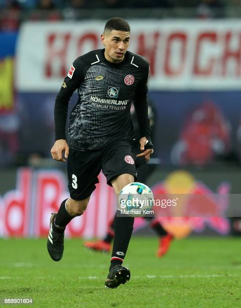 Leon Balogum of Mainz runs with the ball during the Bundesliga match between RB Leipzig and 1FSV Mainz 05 at Red Bull Arena on December 9 2017 in...