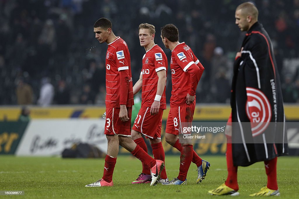 Leon Balogun (L), Johannes van den Bergh (C) and Robert Tesche (R) of Duesseldorf frustration after Bundesliga match between VfL Borussia Moenchengladbach v Fortuna Duesseldorf at Borussia Park Stadium on January 26, 2013 in Moenchengladbach, Germany.