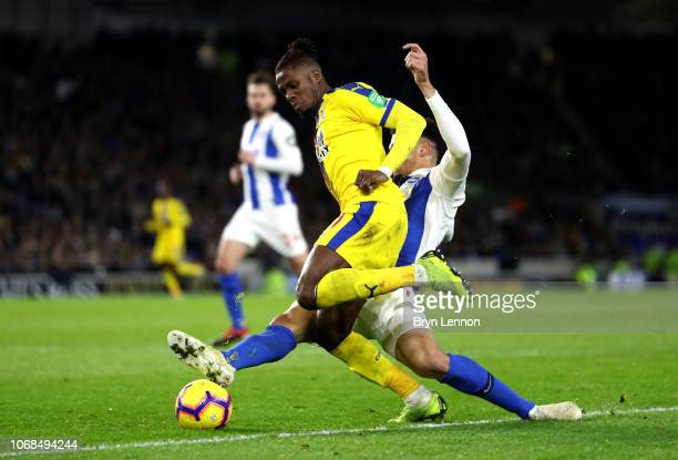 Leon Balogun of Brighton and Hove Albion fouls Wilfried Zaha of Crystal Palace inside the penalty area leading to Crystal Palace being awarded a...