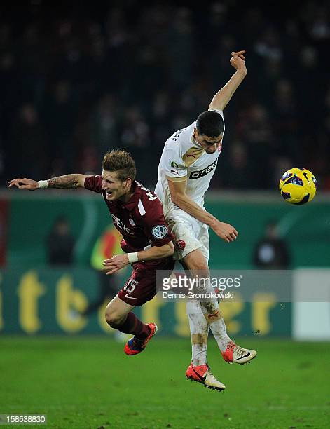 Leon Balogun of Duesseldorf and Andre Hahn of Offenbach battle for the ball during the DFB Cup match between Kickers Offenbach and Fortuna...