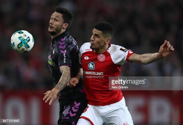 Leon Balogun of Mainz is challenged by Tim Kleindienst of Freiburg during the Bundesliga match between 1 FSV Mainz 05 and SportClub Freiburg at Opel...
