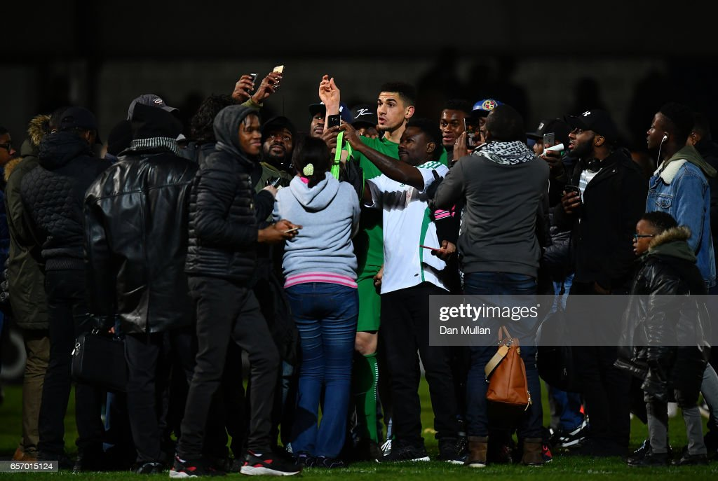 Leon Balogun of Nigeria is mobbed by fans on the pitch following the final whistle during the International Friendly match between Nigeria and Senegal at The Hive on March 23, 2017 in Barnet, England.