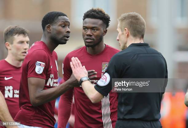 Leon Barnett of Northampotn Town makes apoint to referee Michael Salisbury after Salisbury had shown a red card to Ash Taylor during the Sky Bet...