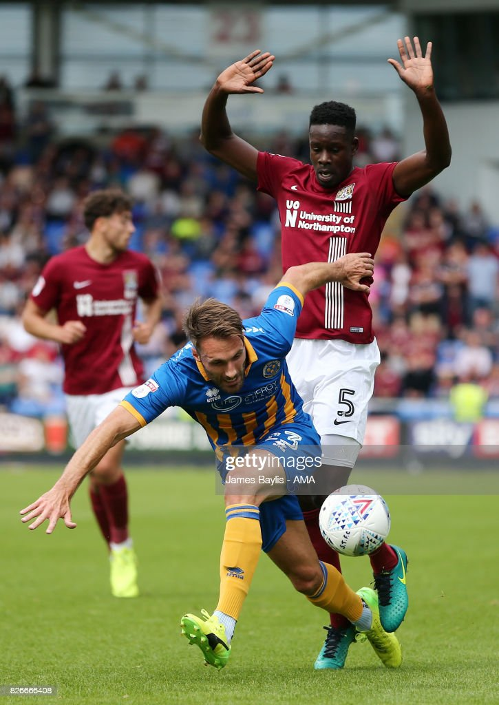 Leon Barnett of Northampton Town and Alex Rodman of Shrewsbury Town during the Sky Bet League One match between Shrewsbury Town and Northampton Town at New Meadow on August 5, 2017 in Shrewsbury, England.