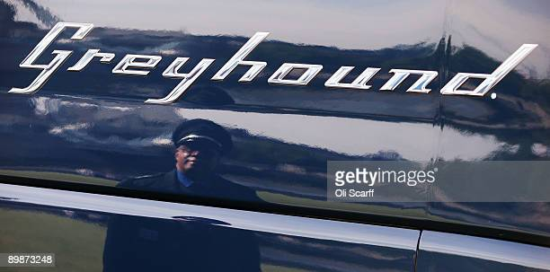 Leon Batchelor a Greyhound coach driver from Philadelphia is reflected in the first Greyhound coach to operate in the UK on August 19 2009 in London...