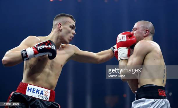 Leon Bauer of Germany exchange punches with Marco Miano of Italy during their super middleweight fight at Arena Nurnberger on February 24 2018 in...