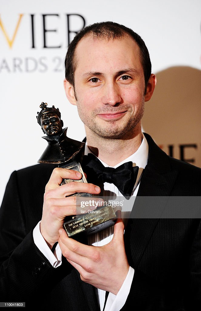 Leon Baugh, winner of Best Theatre Choreographer for 'Sucker Punch' poses in the press room during The Olivier Awards 2011 at Theatre Royal on March 13, 2011 in London, England.