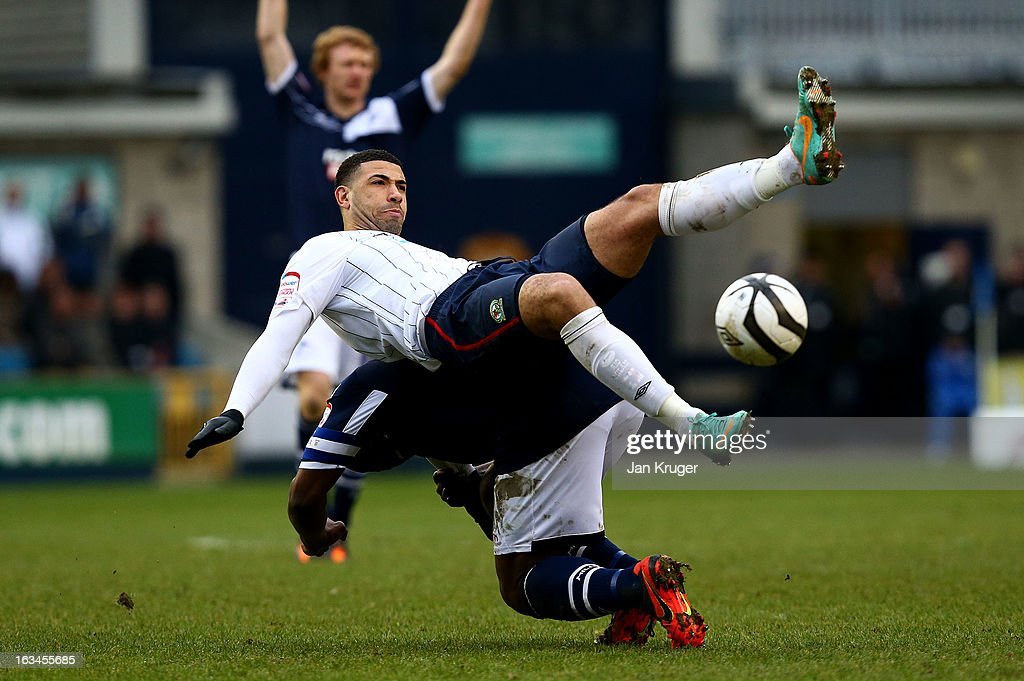 Leon Best of Blackburn Rovers loses his footing under pressure from Danny Shittu of Millwall during the FA Cup sponsored by Budweiser sixth round match between Millwall and Blackburn Rovers at The Den on March 10, 2013 in London, England.