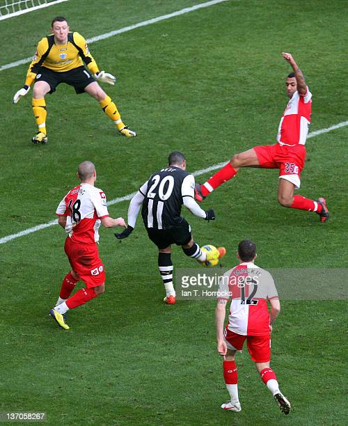 Leon Best of Newcastle scores the opening goal during the Barclays Premier League match between Newcastle United and Queens Park Rangers at Sports...