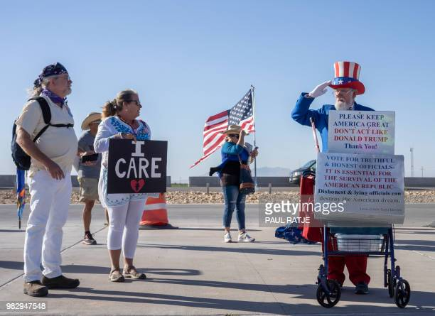 """Leon Blevins, dressed as Uncle Sam, salutes other attendees during the """"End Family Detention,"""" event held at the Tornillo Port of Entry in Tornillo,..."""