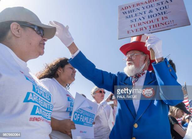 Leon Blevins dressed as Uncle Sam salutes other attendees during the 'End Family Detention' event held at the Tornillo Port of Entry in Tornillo...