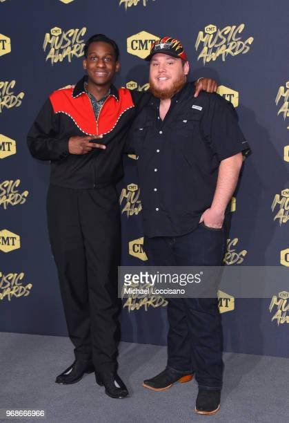 Leon Bridges and Luke Combs attend the 2018 CMT Music Awards at Bridgestone Arena on June 6 2018 in Nashville Tennessee