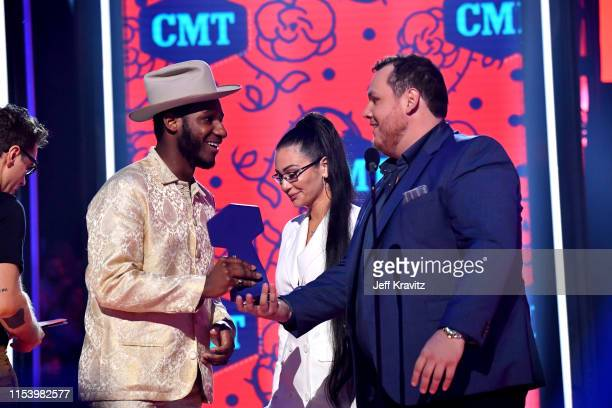 Leon Bridges and Luke Combs onstage at the 2019 CMT Music Awards at Bridgestone Arena on June 05, 2019 in Nashville, Tennessee.