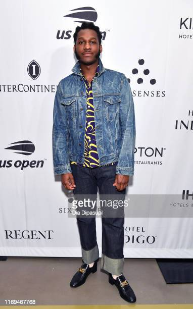 """Leon Bridges walks the red carpet before a performance at the IHG """"Legends, Unmatched"""" party at the Kimpton Hotel Eventi on August 21, 2019 in New..."""