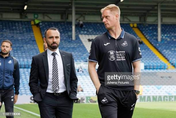 Leon Britton and Alan Tate of Swansea arrive prior to the game during the Sky Bet Championship match between Leeds United and Swansea City at Elland...