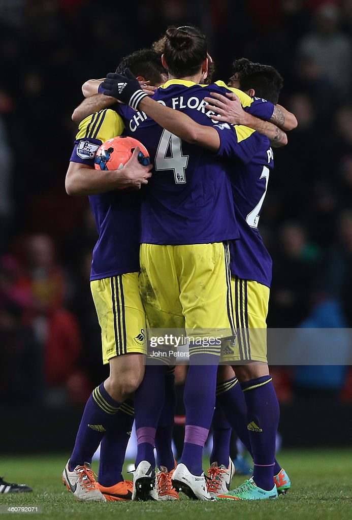 Leon Britton and Chico Flores of Swansea City celebrate after during the FA Cup Third Round match between Manchester United and Swansea City at Old Trafford on January 5, 2014 in Manchester, England.
