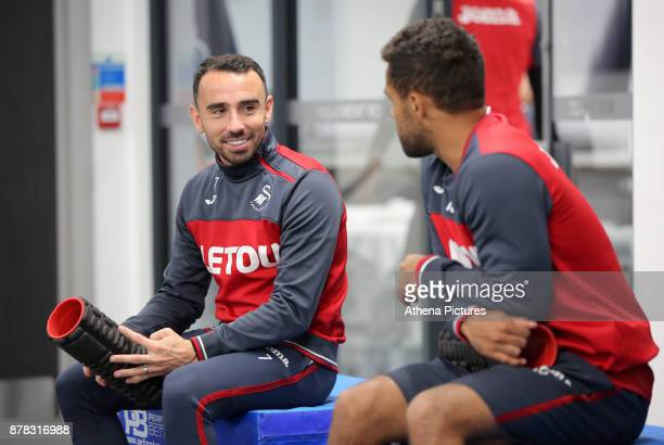 Leon Britton and Wayne Routledge chat in the gym during the Swansea City Training at The Fairwood Training Ground on November 22 2017 in Swansea Wales