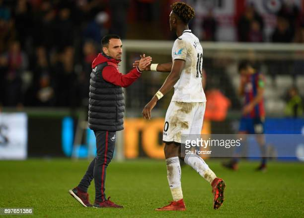 Leon Britton Caretaker manager Player/Manager of Swansea City and Tammy Abraham of Swansea City shake hands after the Premier League match between...