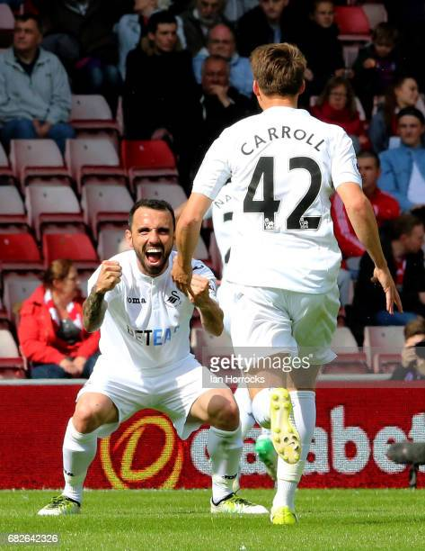 Leon Britton of Swansea celebrates the second goal with Tom Carroll during the Premier League match between Sunderland and Swansea City at Stadium of...