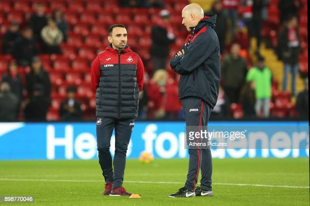 Leon Britton of Swansea City and Cameron Toshack prior to kick off of the Premier League match between Liverpool and Swansea City at Anfield on...