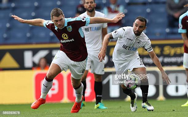 Leon Britton of Swansea City and Sam Vokes of Burnley during the Premier League match between Burnley and Cardiff City at Turf Moor on August 13 2016...