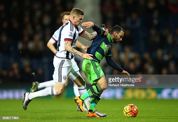 Leon Britton of Swansea City controls the ball under pressure of James McClean of West Bromwich Albion during the Barclays Premier League match...
