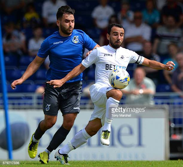 Leon Britton of Swansea City is tackled by Jake Gosling of Bristol Rovers during the PreSeason Friendly match between Bristol Rovers and Swansea City...