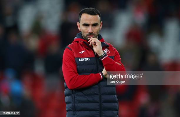 Leon Britton of Swansea City looks on as caretaker manager during the Premier League match between Liverpool and Swansea City at Anfield on December...