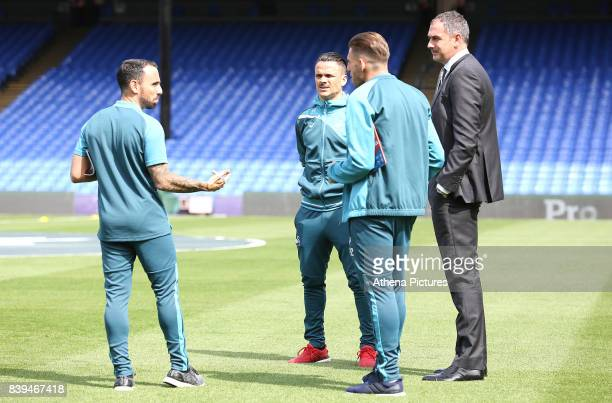 Leon Britton of Swansea City talks with Roque Mesa of Swansea City Angel Rangel of Swansea City and Swansea City manager Paul Clement prior to kick...