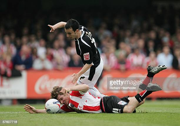 Leon Britton of Swansea tussles with Jay Tabb of Brentford during the Coca-Cola League One 2nd leg play-off semi final between Brentford and Swansea...
