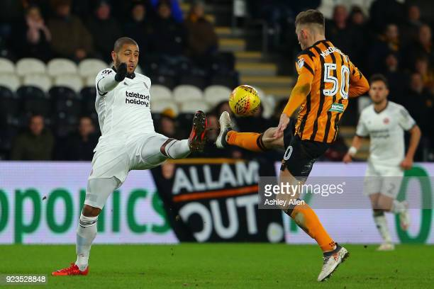 Leon Clarke of Sheffield United and Angus MacDonald of Hull City in action during the Sky Bet Championship match between Hull City and Sheffield...