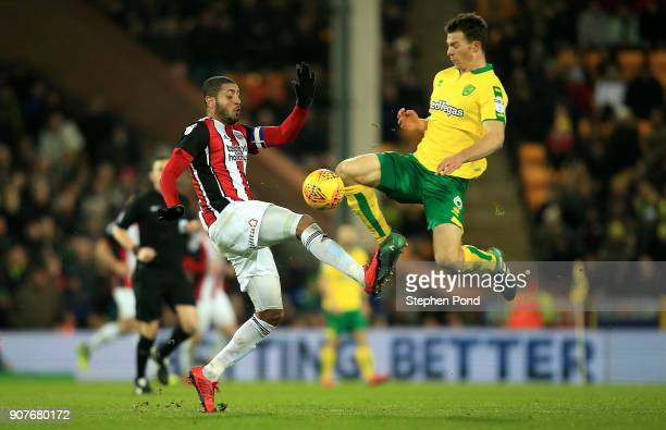Leon Clarke of Sheffield United and Christoph Zimmermann of Norwich City compete for the ball during the Sky Bet Championship match between Norwich...