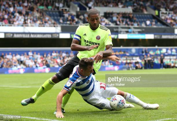 Leon Clarke of Sheffield United and Josh Scowen of Queens Park Rangers during the Sky Bet Championship match between Queens Park Rangers and...